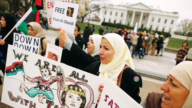 Libyan-American women showing solidarity with Iman al-Obeidi in Lafayette Park in front of the White House in Washington, DC on March 30. On March 26, Ms al-Obeidi went to the hotel in Tripoli where the foreign media were staying and claimed she had been arrested, beaten and repeatedly raped by armed men of the Gaddafi regime. Photo: Chip Somodevilla/Getty Images/AFP
