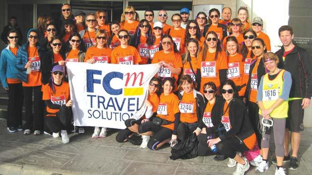 Josette Falzon, kneeling to right of banner, was part of a large group taking part in the walkathon to raise funds for the Cystic Fibrosis Trust.