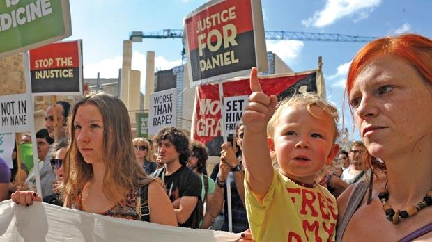 Marzena Holmes and her daughter Rainbow at the protest yesterday. Photo: Chris Sant Fournier