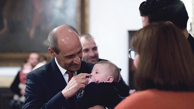 Health Minister Chris Fearne holding one of the IVF babies. Photo: DOI