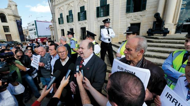General Workers Union general secretary Tony Zarb speaks to reporters outside Castille as ex-port workers call to receive payment from their pension fund. Photo: Darrin Zammit Lupi