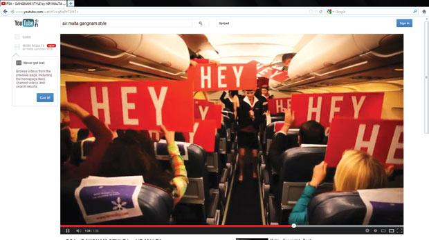 A screengrab from the You Tube video shows 'passengers' lifting up placards for the song's chorus.