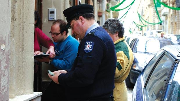 Police distributing voting documents for the 2008 election. Photo: Darrin Zammit Lupi