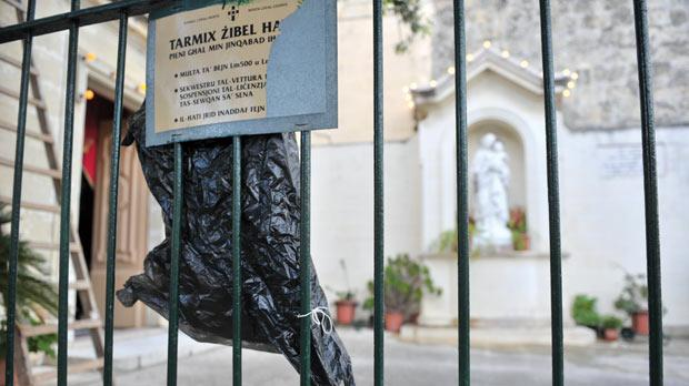 The garbage bag covers the carcass of a crucified cat found hung to the gate of a chapel in San Anton Abbati Street, Mosta, on January 17 last year. Photo: Jason Borg