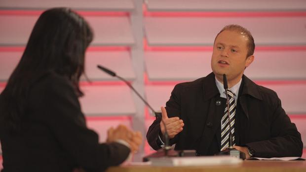 Labour leader Joseph Muscat gestures during an open-air interview in Qrendi last night. Photo: Matthew Mirabelli