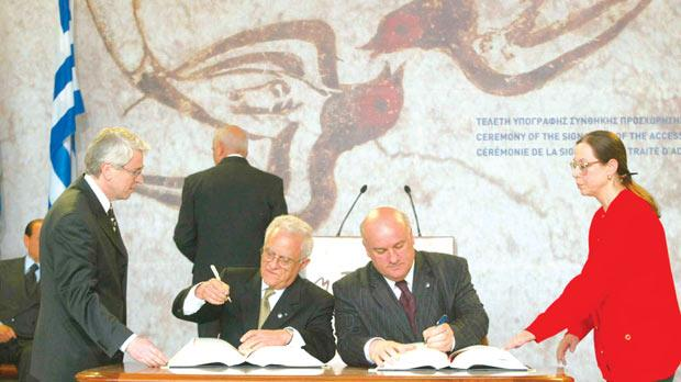 Then Prime Minister Eddie Fenech Adami and then Foreign Minister Joe Borg signing the EU accession treaty in Athens in 2003.