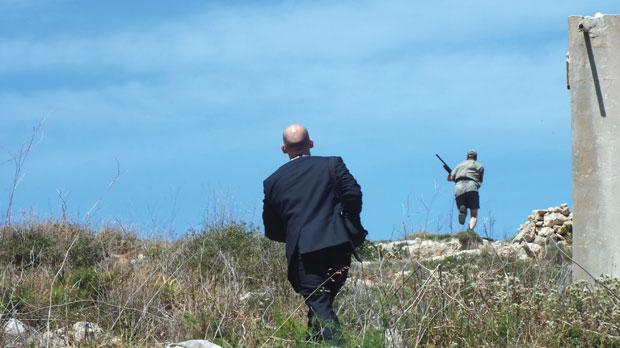 A planning enforcement officer runs after a hunter in the Foresta 2000 Bird Sanctuary in Mellieħa on Friday in this photo provided by Birdlife. The NGO's annual spring conservation camp Spring Watch starts today, with 40 international volunteers joining forces to help monitor the spring bird migration and report illegal hunting. Photo: Fiona Burrows