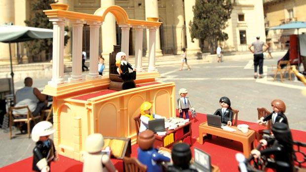 A Playmobil model of Magistrate Antonio Micallef Trigona's courtroom was presented as evidence by a woman yesterday as part of her defence against charges of copyright theft and commercial fraud when she customised Playmobil figurines and re-sold them. The law court building in Republic Street, Valletta provides the backdrop for the scene. Photo: Matthew Mirabelli