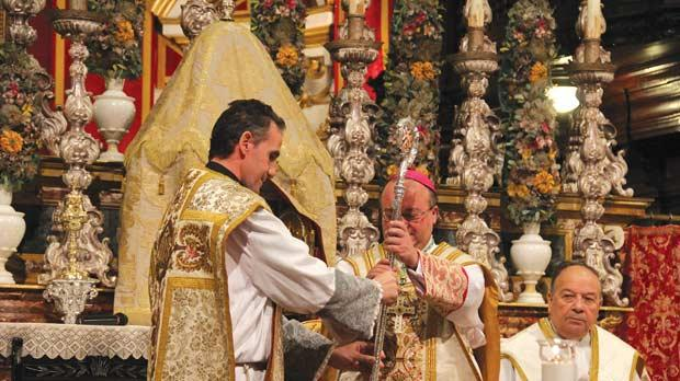 Parish priest David Gauci presents a crozier to Mgr Charles Scicluna. Photo: Paul Spiteri Lucas