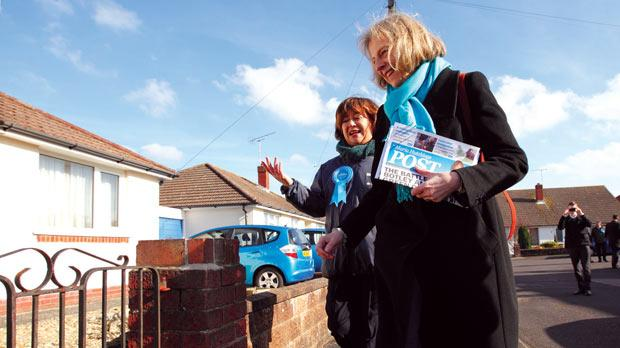 Maria Hutchings, left, on the campaign trail with UK Home Secretary Theresa May in Eastleigh, Hampshire, yesterday. Photo: PA