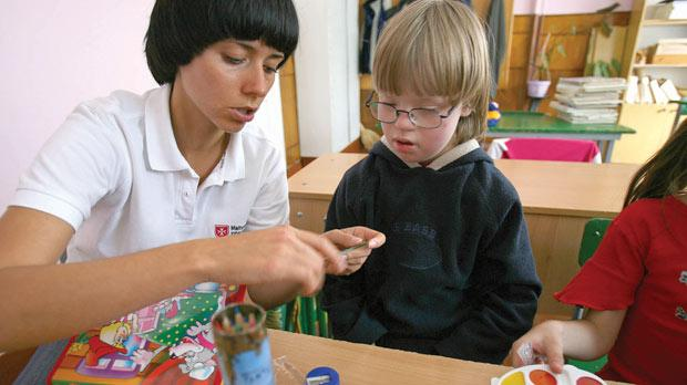 A Knights of Malta volunteer working at a children's home in Ukraine.