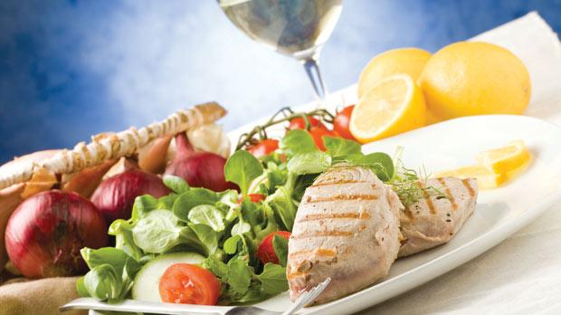 A diet rich in olive oil, vegetables, fish, beans, white meat and even wine can cut the risk of cardiovascular problems.