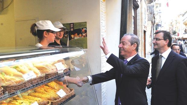 Dr Gonzi visiting commercial outlets in Valletta's Merchants Street. Photo: Chris Sant Fournier