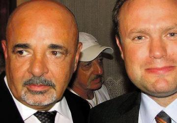 Mario Azzopardi, pictured with Joseph Muscat, is a director of a four-star hotel owned by a joint venture between the Maltese government and a Libyan investment company.