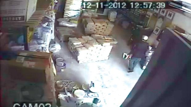 In this CCTV footage uploaded on You Tube, a man is seen casually entering a warehouse .