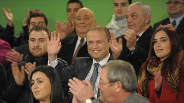Joseph Muscat waves to party supporters in Birkirkara yesterday. Photo: Matthew Mirabelli