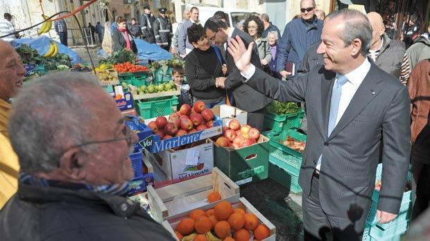 Lawrence Gonzi greets well-wishers during a visit to shops and hawkers in Żabbar yesterday. Photo: Chris Sant Fournier