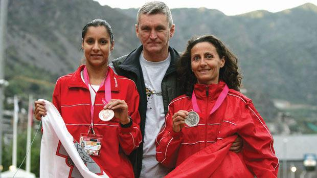 John Walsh flanked by his wife Carol née Galea (right) and Lisa Marie Bezzina at the Small Nations' Games in Andorra in 2005. Photo: Darrin Zammit Lupi