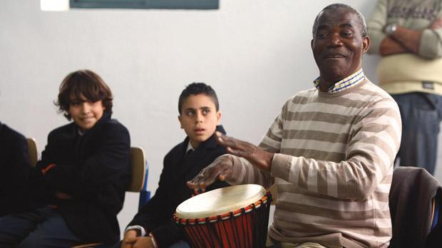 Kipasa Prosper teaching drumming to students. Photo: Darrin Zammit Lupi