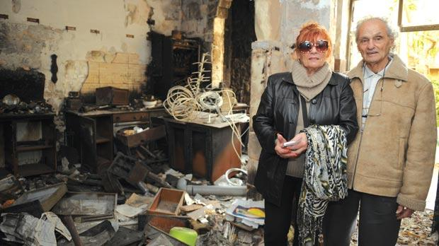 Alex Borg Caruana and his wife Marie Therese revisit their burnt home. Photo: Matthew Mirabelli