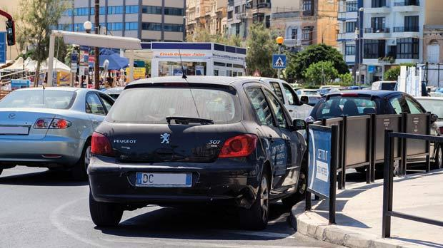 Malta registered cars get fined foreigners evade it a car with a number plate registered in italy parked illegally in sliema photo sciox Images