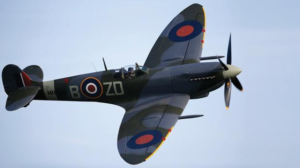The Spitfire roars past the crowds at the airshow yesterday.