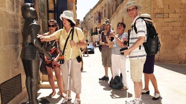 Seeing is feeling... A group of blind travellers discover Mdina.
