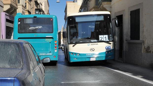 Most Arriva buses measure 2.55 metres wide, exactly the width limit established by Maltese law. The photo by Chris Sant Fournier shows two buses barely making it past each other in Mrabat Street, Sliema.
