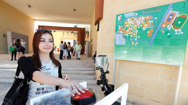 Passers-by at the university campus are being invited to voice their opinons on the way they envision Malta in six years' time. Photo: Darrin Zammit Lupi
