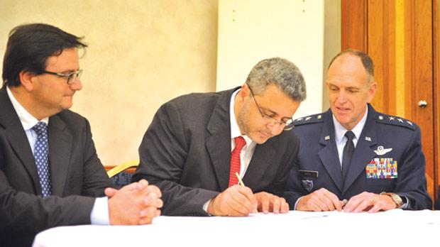 The Nato-Libya flights agreement being signed by Libyan Provisional Government Transport Minister Anwar El Feitori and Lt General Ralph J. Jodice for Nato. Also in the picture is Finance Minister Tonio Fenech. Photo: Jason Borg