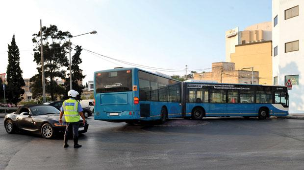 One of Malta's bendy buses trying to turn on a roundabout. Photo: Chris Sant Fournier