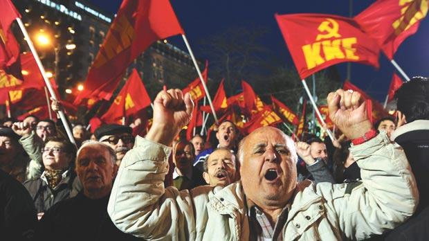 Greece's Communist party (KKE) demonstrators shouting slogans during a demonstration in Athens, yesterday. Greece received a first disbursement of €7.5 billion under its second international bailout.