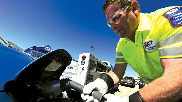 John Nielsen of the AAA demonstrating how to charge a Nissan Leaf electric car from an AAA roadside assistance truck.
