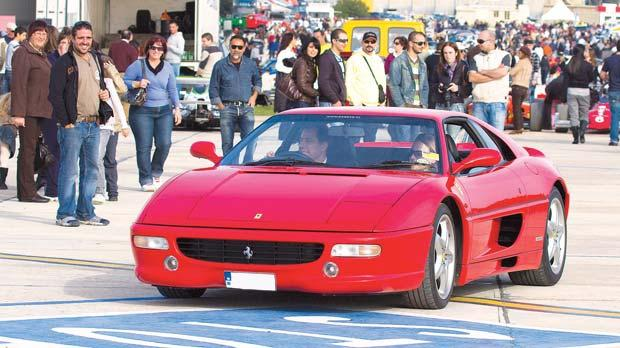 The President and Mrs Abela trying out a Ferrari at last year's Paqpaqli għall-Istrina.