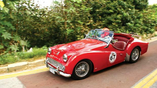 Ex-Formula One driver Rupert Keegan driving a local Triumph TR3.