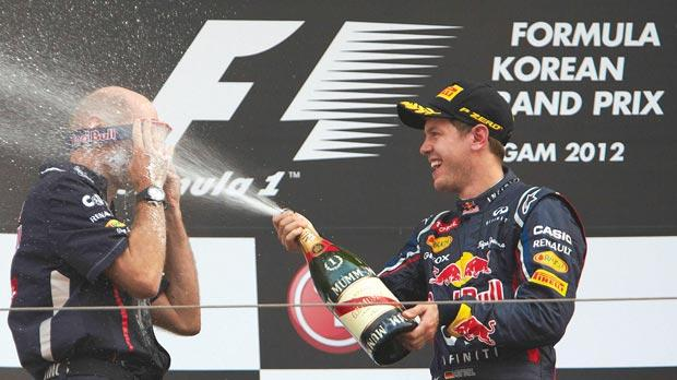 Korea – Red Bull's Adrian Newey defends himself from a bubbly shower from Vettel by wearing a pair of goggles.