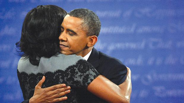 Barack Obama hugging his wife Michelle. Photo:AFP