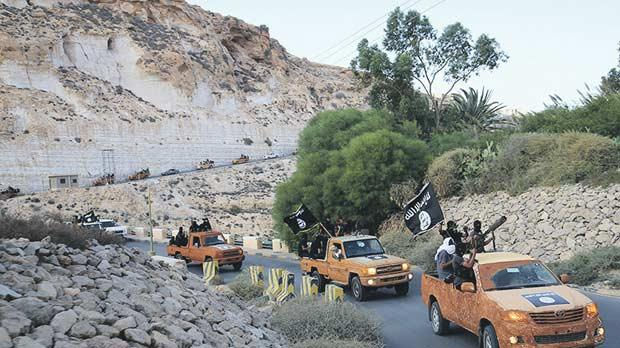 An armed motorcade belonging to members of Derna's Islamic Youth Council, consisting of former members of militias from the town of Derna, drive along a road in Derna in 2014. The group pledged allegiance to Daesh. Photo: Reuters