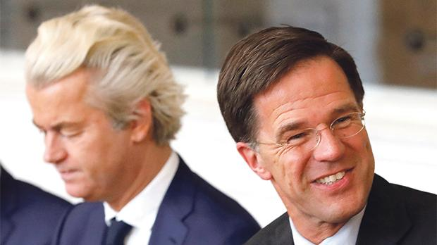 Prime Minister Mark Rutte, right, of the Liberal Party (VVD), and far-right politician Geert Wilders of the Freedom Party (PVV), take part in a meeting at the Dutch Parliament after the general election in The Hague. Photo: Reuters