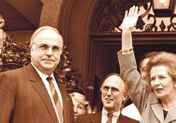 Former British prime minister Margaret Thatcher waving to well-wishers as Helmut Kohl (left) looks on. Photo: Reuters