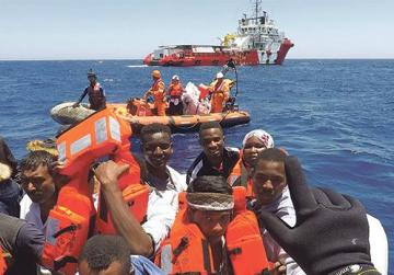 Migrants on a dinghy are rescued by Save the Children NGO crew from the ship Vos Hestia off Libya coast earlier last month. Photo: Stefano Rellandini/Reuters