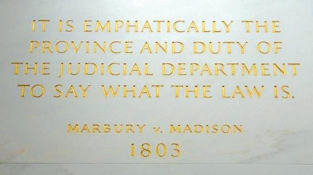 The inscription on the wall of the US Supreme Court Building from Marbury v. Madison, in which Chief Justice John Marshall outlined the concept of judicial review.