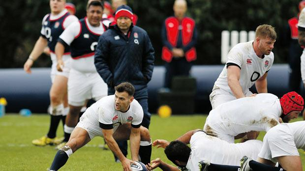 England's Danny Care is ready to pass the ball during training as coach Eddie Jones looks on.