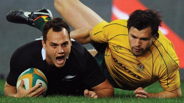 Israel Dagg scores a try despite an attempted tackle by Adam Ashley-Cooper, of Australia.