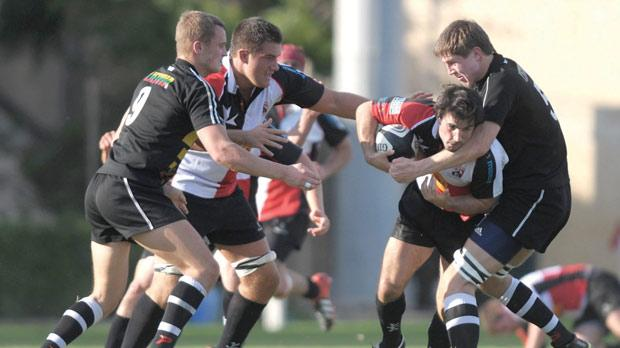 Malta's fly-half RobHolloway charges forward against Lithuania. Photo:Matthew Mirabelli