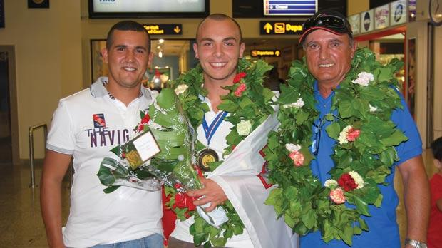 Nathan Lee Xuereb flanked by coach Jimmy Bugeja (right) and William Chetcuti, yesterday.