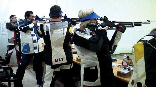 Air-rifle shooters at the indoor range in Bidnija.