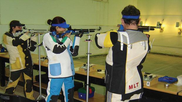 Marianna Kisvardai (centre) shooting her way to victory.