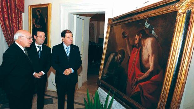 Picture shows Dr Abela with Mario Costa (left) and Joseph Mizzi viewing a Preti masterpiece set up for the occasion. Photo: DOI/Omar Camilleri