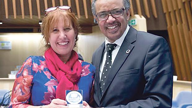 Dr Licari receiving the DG Reward for Excellence from WHO Director General Tedros Adhanom.